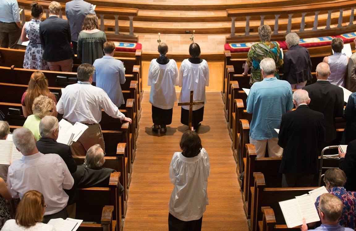 Children and youth often serve as acolytes in The United Methodist Church. They may carry in the light of Christ, the processional cross, banners or Bible. Photo by Mike DuBose, UMCom.