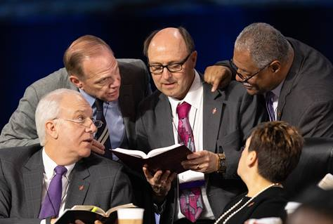 Bishops confer over the issue of whether the legislative committee can refer items to the denomination's Judicial Council for review during the 2019 United Methodist General Conference in St. Louis. Clockwise from lower left are Bishops Thomas Bickerton, John Schol, David Bard, Julius C. Trimble and Cynthia Fierro Harvey. Photo by Mike DuBose, UMNS.