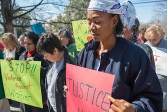 The Rev. Eunice Musa Iliya (right) participates in an International Women's Day vigil, sponsored by United Methodist Women. Photo by Kristina Krug courtesy of United Methodist Women.