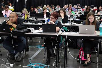 The newsroom of the 2016 United Methodist General Conference in Portland, Ore. is a busy place with journalists covering sessions.