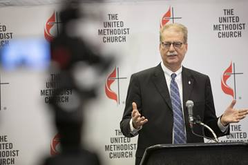 Bishop Kenneth H. Carter, president of the Council of Bishops, speaks to the press following the conclusion of the 2019 United Methodist General Conference.