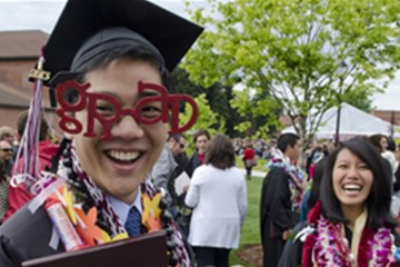 Student celebrates after graduation at the University of Puget Sound in Tacoma, WA. Photo courtesy of Ross Mulhausen, University of Puget Sound.