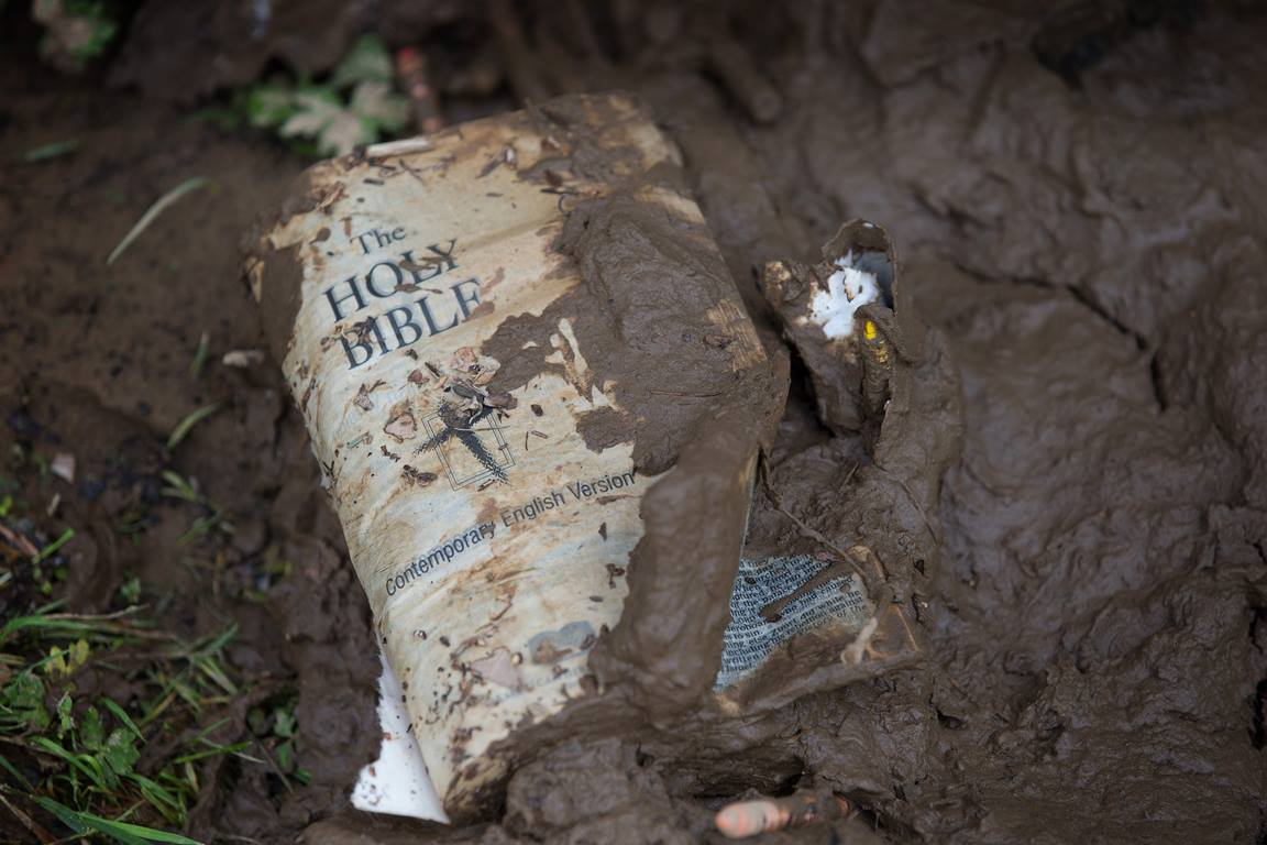 A Bible coated in mud lies outside Fenwick (W. Va.) United Methodist Church following heavy flooding. Photo by Mike DuBose, UM News.