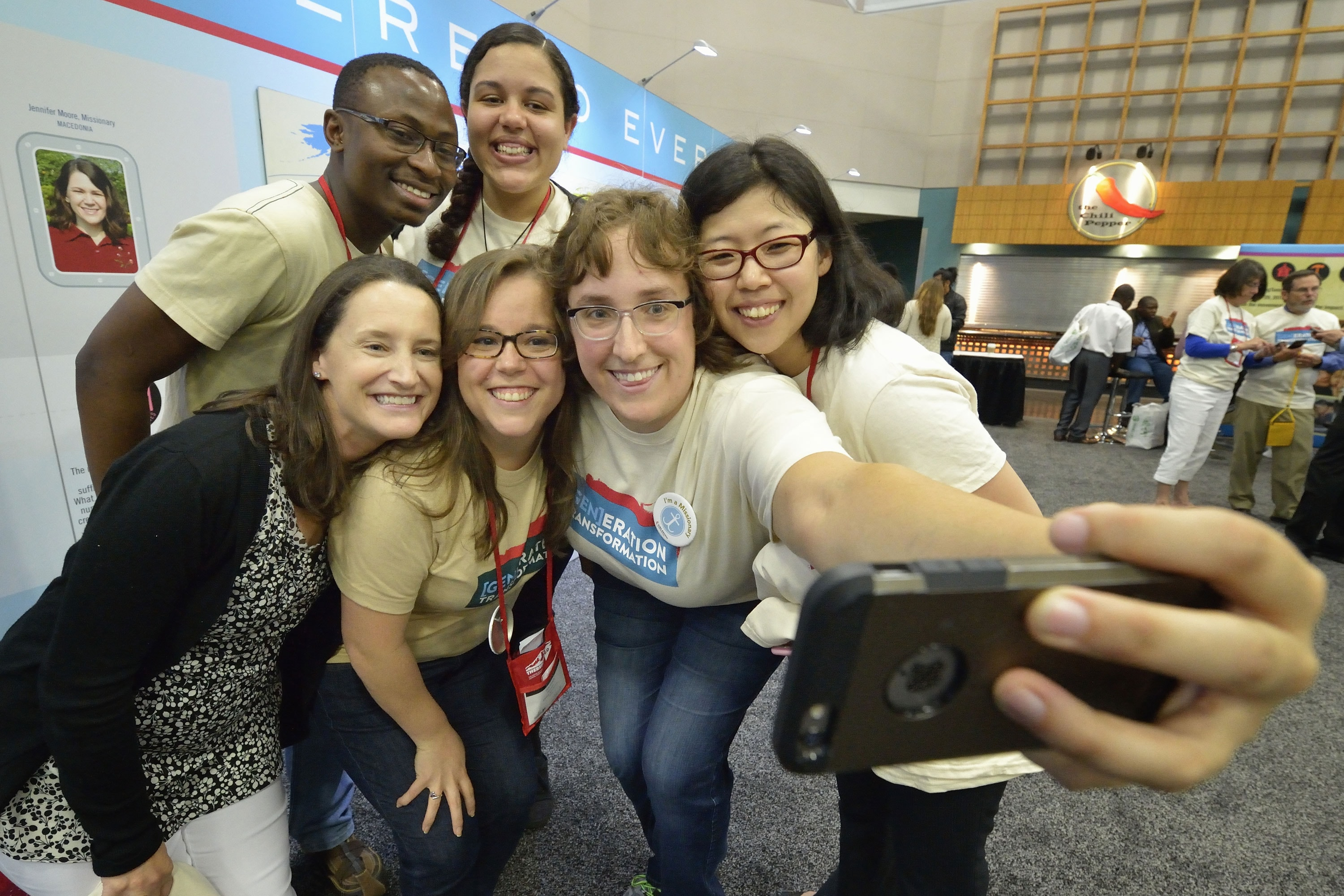 Young adult mission workers pose at the United Methodist Global Ministries exhibit at the 2016 United Methodist General Conference in Portland, Ore. Photo by Paul Jeffrey, United Methodist Communications.