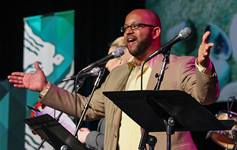 """The Rev. R. DeAndre Johnson sings during morning worship at the 2016 United Methodist General Conference in Portland, Ore. Johnson, a delegate to the conference, has written a hymn called """"It Is Enough"""" in response to George Floyd's death and earlier tragedies like it. File photo by Maile Bradfield, UM News."""